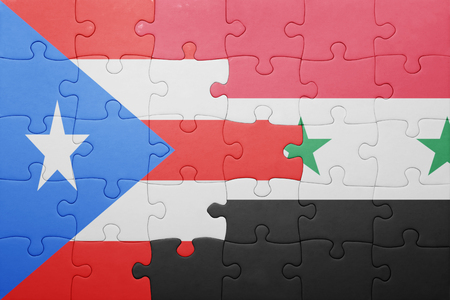 bandera de puerto rico: puzzle with the national flag of puerto rico and syria . concept