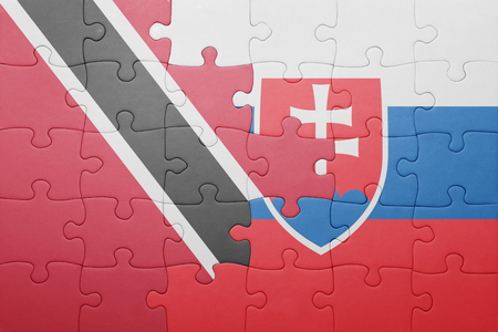 national flag trinidad and tobago: puzzle with the national flag of slovakia and trinidad and tobago . concept Stock Photo