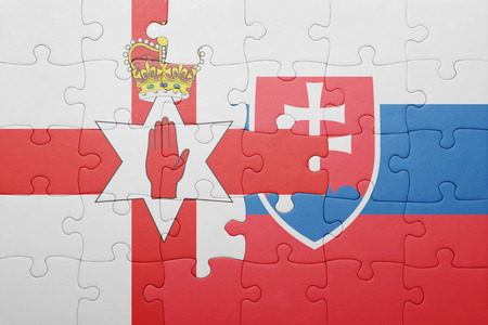 northern ireland: puzzle with the national flag of slovakia and northern ireland . concept