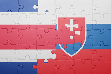 costa rican flag: puzzle with the national flag of slovakia and costa rica . concept
