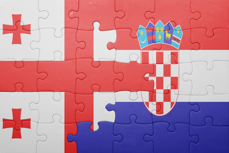 puzzle with the national flag of georgia and croatia . concept Stock Photo