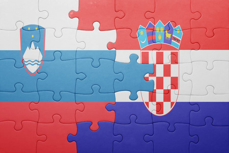 puzzle with the national flag of slovenia and croatia . concept