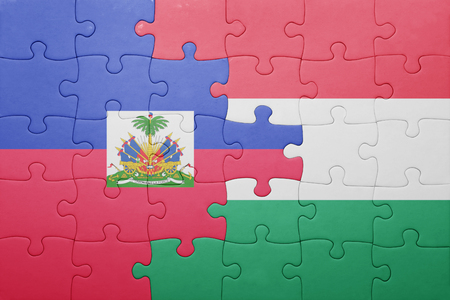 port au prince: puzzle with the national flag of haiti and hungary . concept