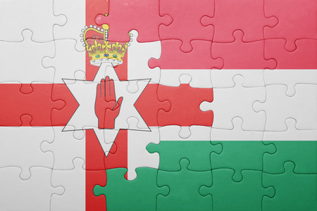 northern ireland: puzzle with the national flag of northern ireland and hungary . concept