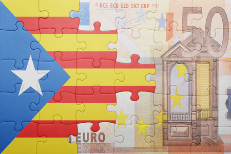 european integration: puzzle with the national flag of catalonia and euro banknote . concept