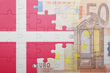 european integration: puzzle with the national flag of denmark and euro banknote . concept Stock Photo