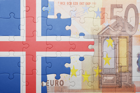 the icelandic flag: puzzle with the national flag of iceland and euro banknote . concept Stock Photo