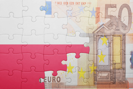 fifty euro banknote: puzzle with the national flag of poland and euro banknote . concept Stock Photo