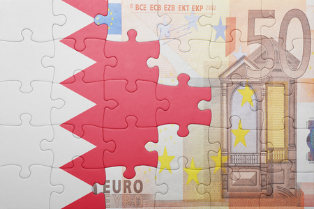 bahrain money: puzzle with the national flag of bahrain and euro banknote . concept