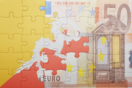 european integration: puzzle with the national flag of bhutan and euro banknote . concept