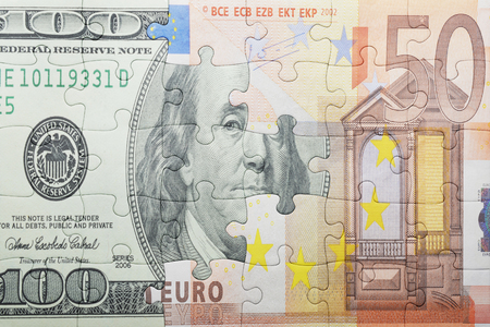 puzzle with the dollar and euro banknote . concept