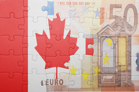 american currency: puzzle with the national flag of canada and euro banknote . concept Stock Photo