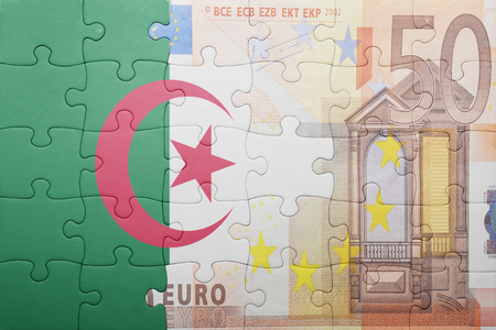 european integration: puzzle with the national flag of algeria and euro banknote . concept Stock Photo