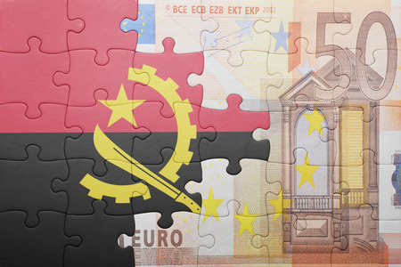 european integration: puzzle with the national flag of angola and euro banknote . concept