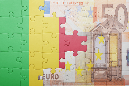 bamako: puzzle with the national flag of mali and euro banknote . concept