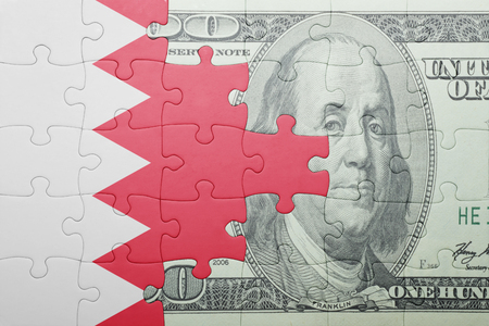 bahrain money: puzzle with the national flag of bahrain and dollar banknote . concept Stock Photo