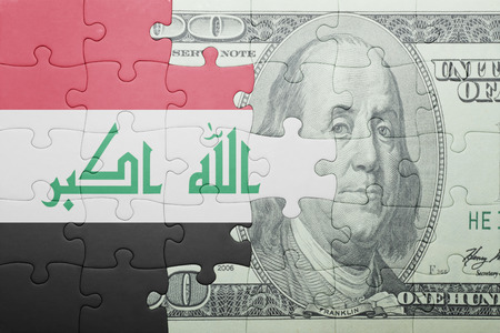 arabic currency: puzzle with the national flag of iraq and dollar banknote . concept