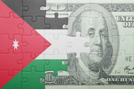 arabic currency: puzzle with the national flag of jordan and dollar banknote . concept Stock Photo