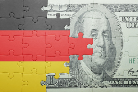 european integration: puzzle with the national flag of germany and dollar banknote . concept Stock Photo