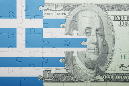 european integration: puzzle with the national flag of greece and dollar banknote . concept Stock Photo