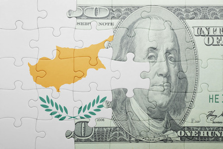 european integration: puzzle with the national flag of cyprus and dollar banknote . concept Stock Photo