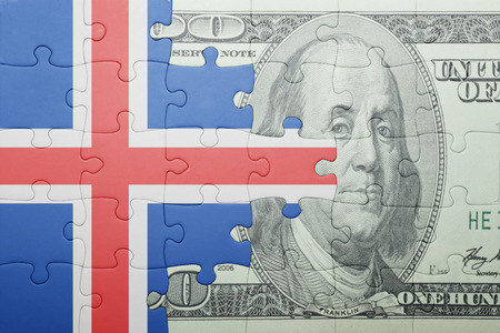 puzzle with the national flag of iceland and dollar banknote . concept