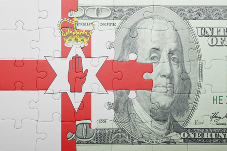 northern ireland: puzzle with the national flag of northern ireland and dollar banknote . concept