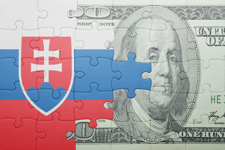 european integration: puzzle with the national flag of slovakia and dollar banknote . concept