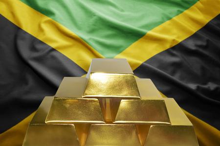 jamaican: shining golden bullions on the jamaican flag background