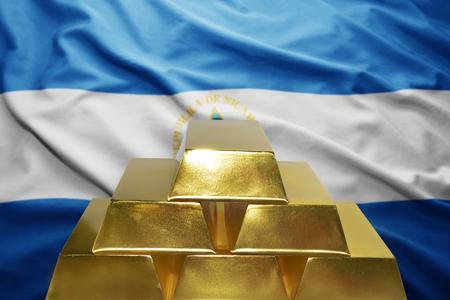 nicaraguan: shining golden bullions on the nicaraguan flag background Stock Photo