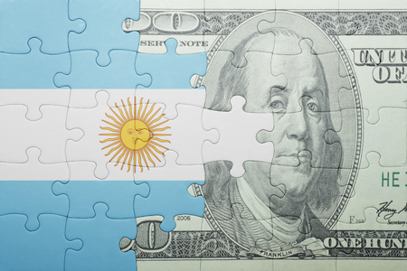 puzzle with the national flag of argentina and dollar banknote . concept Stock Photo