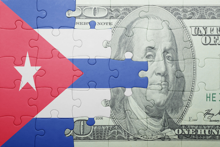 bandera cuba: puzzle con la bandera nacional de Cuba y de los billetes de d�lares. concepto Foto de archivo
