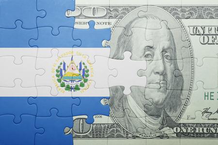 el salvadoran: puzzle with the national flag of el salvador and dollar banknote . concept