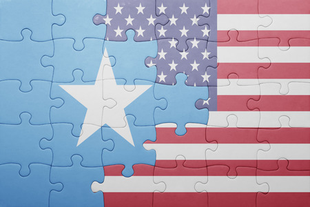 somali: puzzle with the national flag of united states of america and somalia .concept