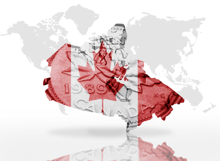 canadian coin: map of canada on the canadian coin texture with canadian flag  world map background Stock Photo