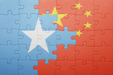 somali: puzzle with the national flag of china and somalia . concept