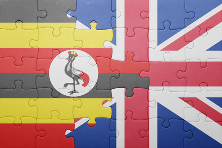 kampala: puzzle with the national flag of great britain and uganda . concept Stock Photo