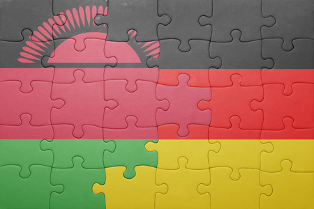 malawi flag: puzzle with the national flag of germany and malawi . concept
