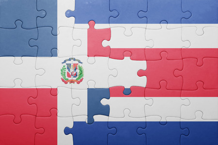 costa rican flag: puzzle with the national flag of costa rica and dominican republic . concept