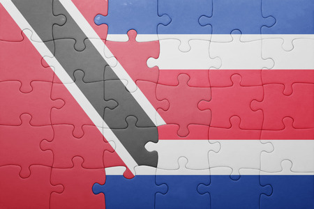 costa rican flag: puzzle with the national flag of costa rica and trinidad and tobago . concept