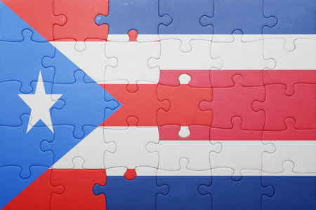costa rican flag: puzzle with the national flag of costa rica and puerto rico . concept