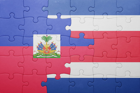 port au prince: puzzle with the national flag of costa rica and haiti . concept