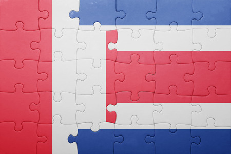 costa rican flag: puzzle with the national flag of costa rica and peru . concept