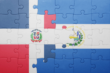 el salvadoran: puzzle with the national flag of el salvador and dominican republic . concept