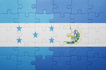 el salvadoran: puzzle with the national flag of el salvador and honduras . concept Stock Photo