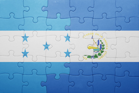 puzzle with the national flag of el salvador and honduras . concept Stok Fotoğraf