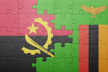 zambian: puzzle with the national flag of zambia and angola . concept