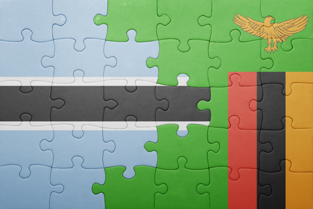 zambian: puzzle with the national flag of zambia and  botswana. concept Stock Photo