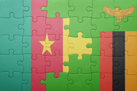 zambian: puzzle with the national flag of zambia and cameroon . concept
