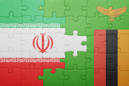 zambian flag: puzzle with the national flag of zambia and iran . concept Stock Photo